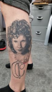 Black and grey portrait tattoo eureka